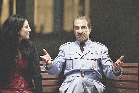 Ronit Elkabetz as Dina and Sasson Gabai as Tewfiq3jjj